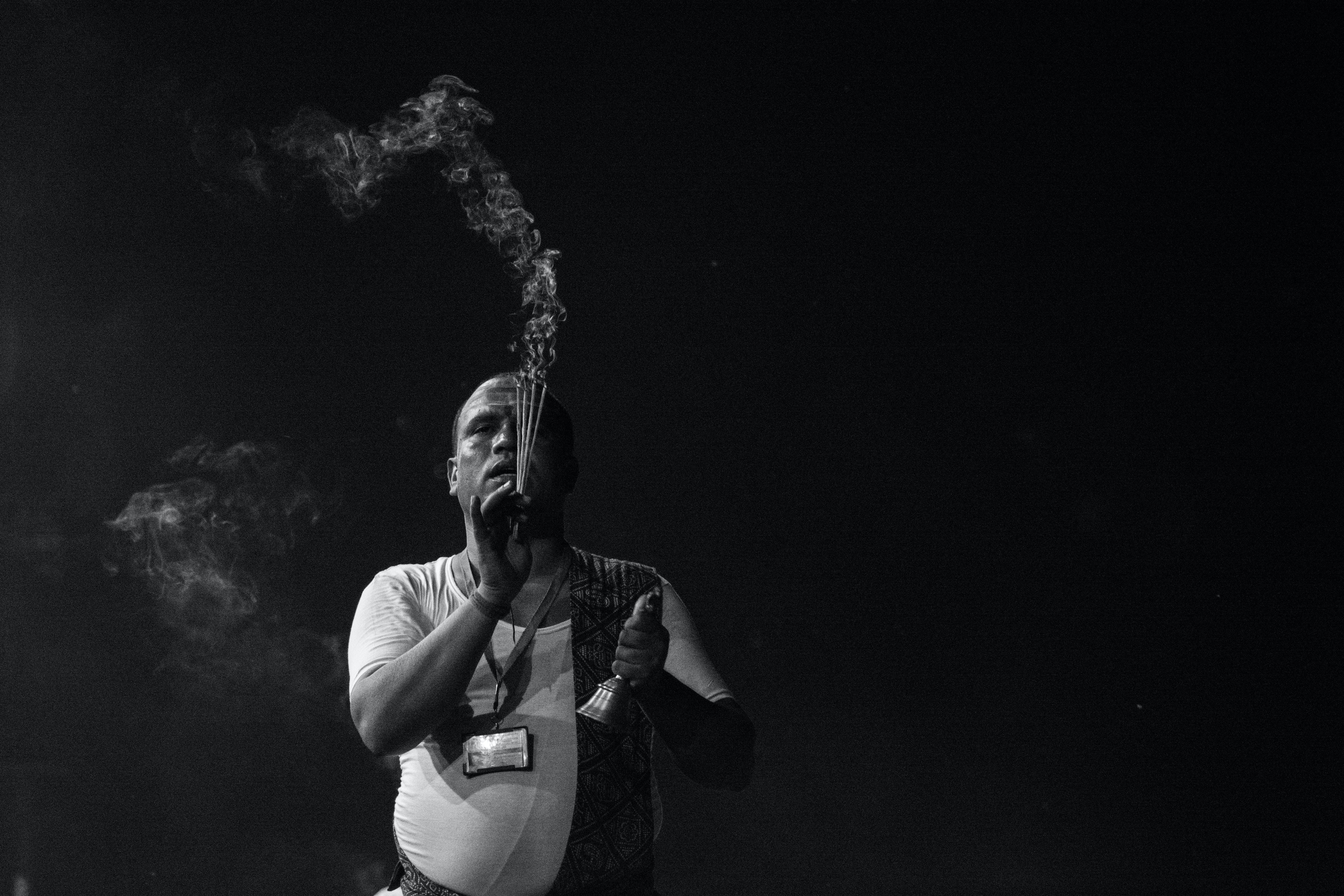 Man Holding Incense