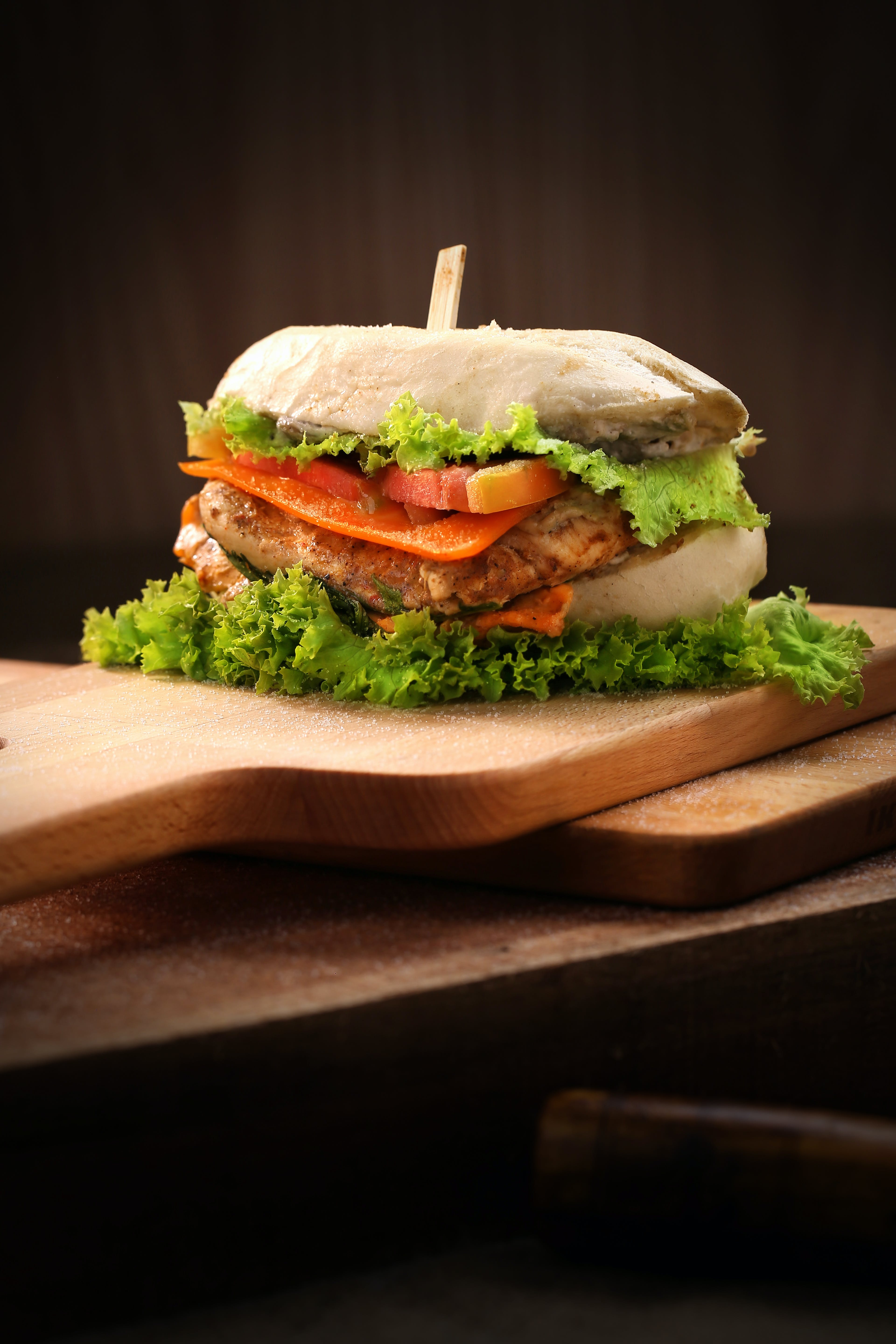 Cheese Burger on Brown Chopping Board
