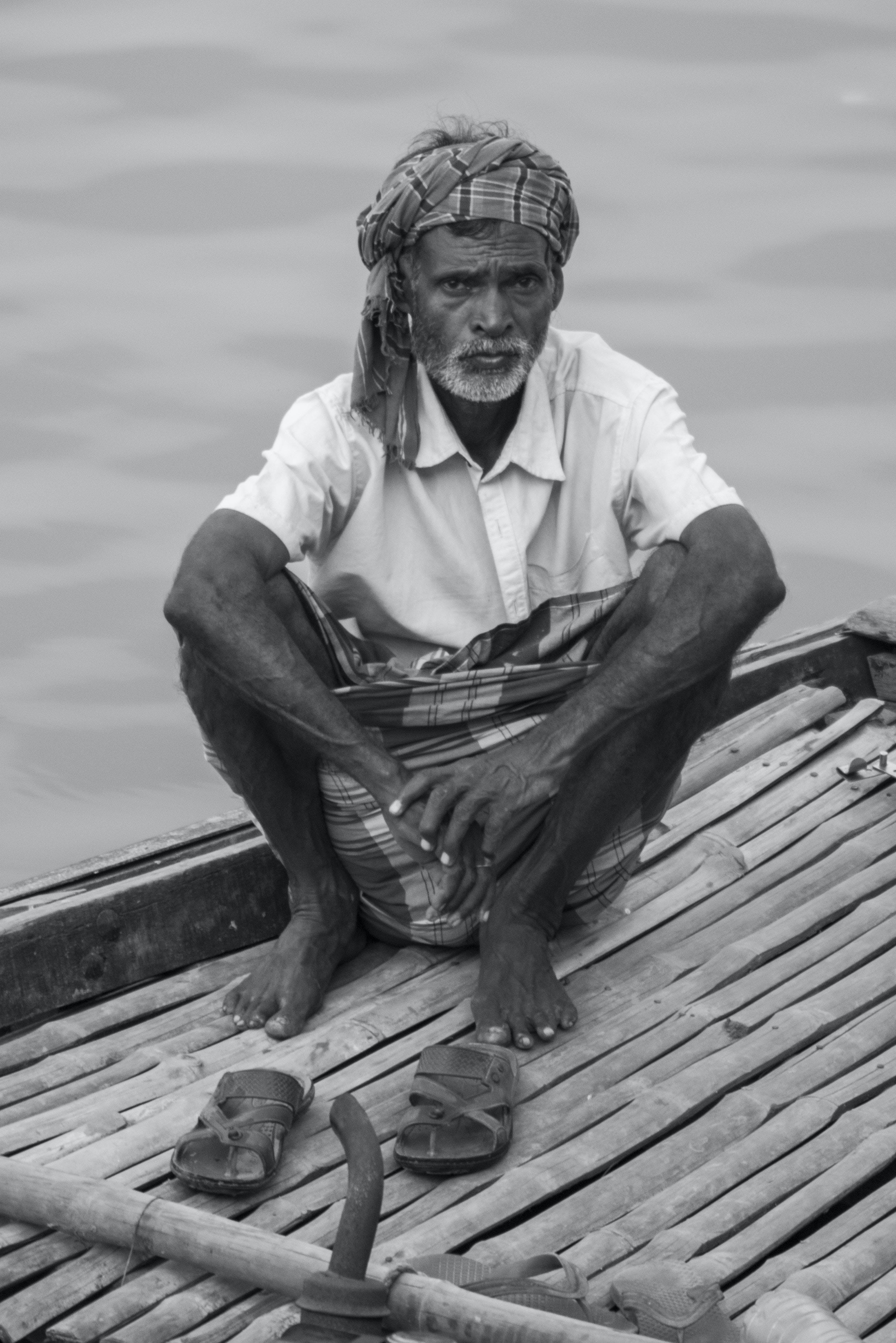 Grayscale Photo Of Man On A Raft
