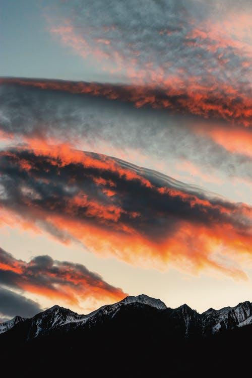 Gratis stockfoto met achtergrond, avond, bergen, bergketen