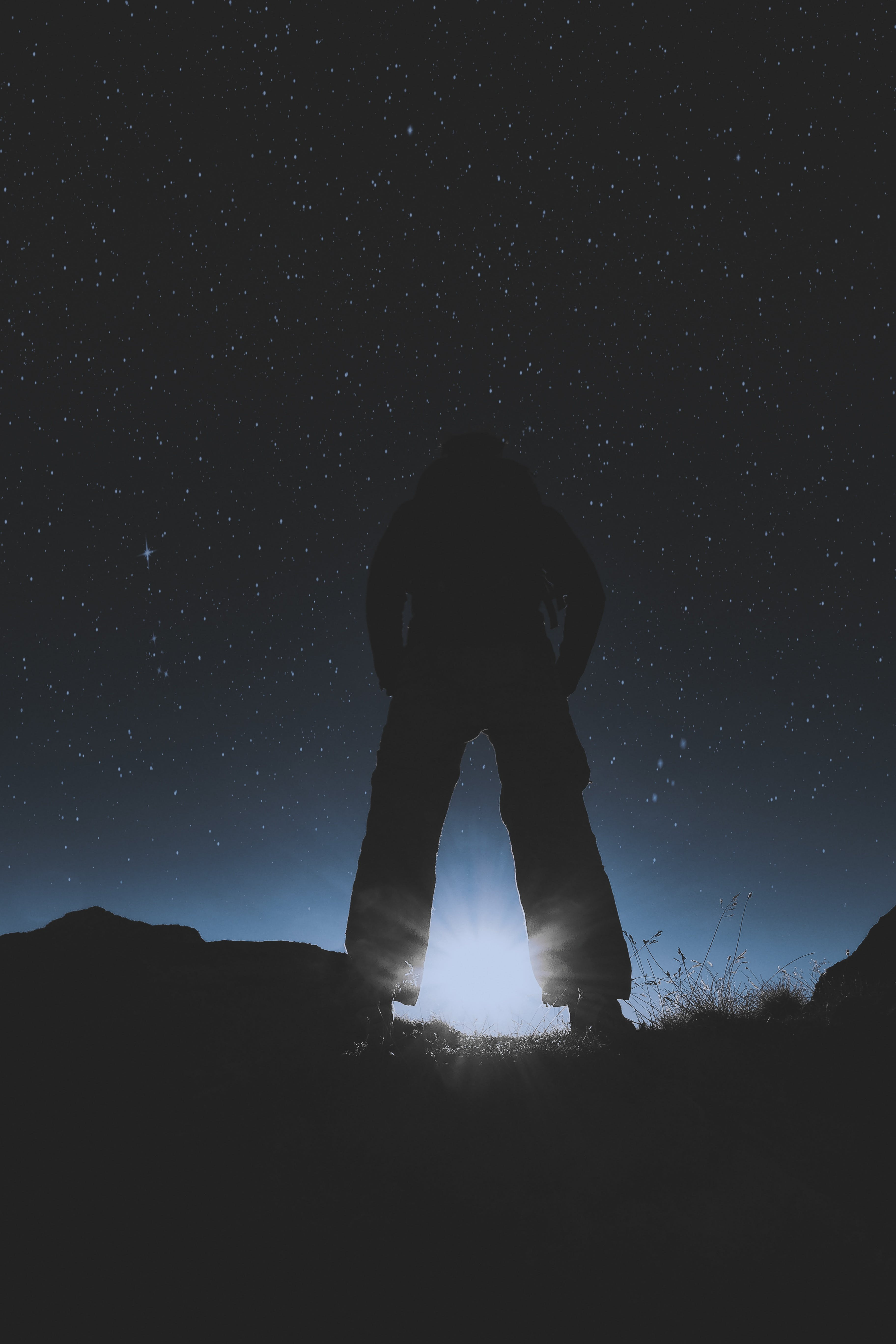 Silhouette of Person Standing Under Starry Night