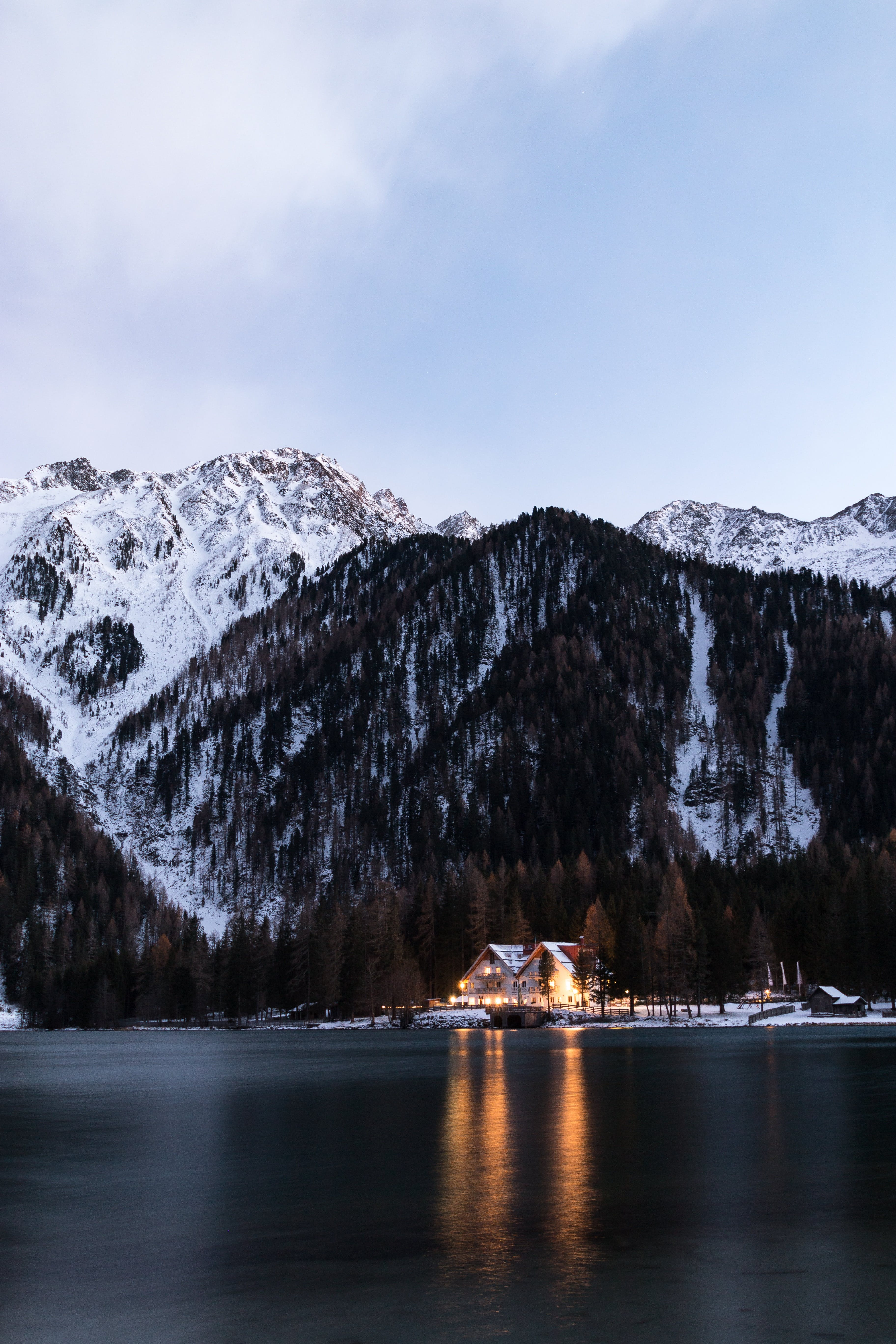 House Between Body of Water and Mountain