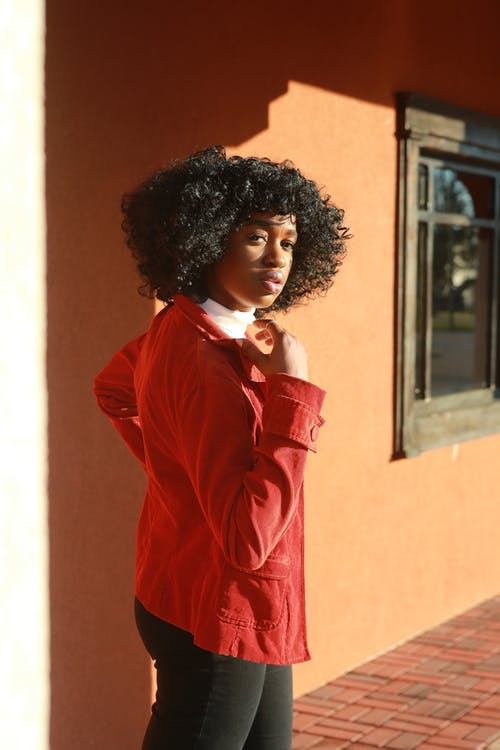 Photo Of Woman Wearing Red Coat