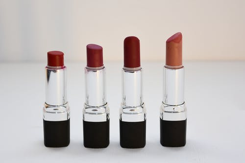 Four Aligned Assorted-color Lipsticks