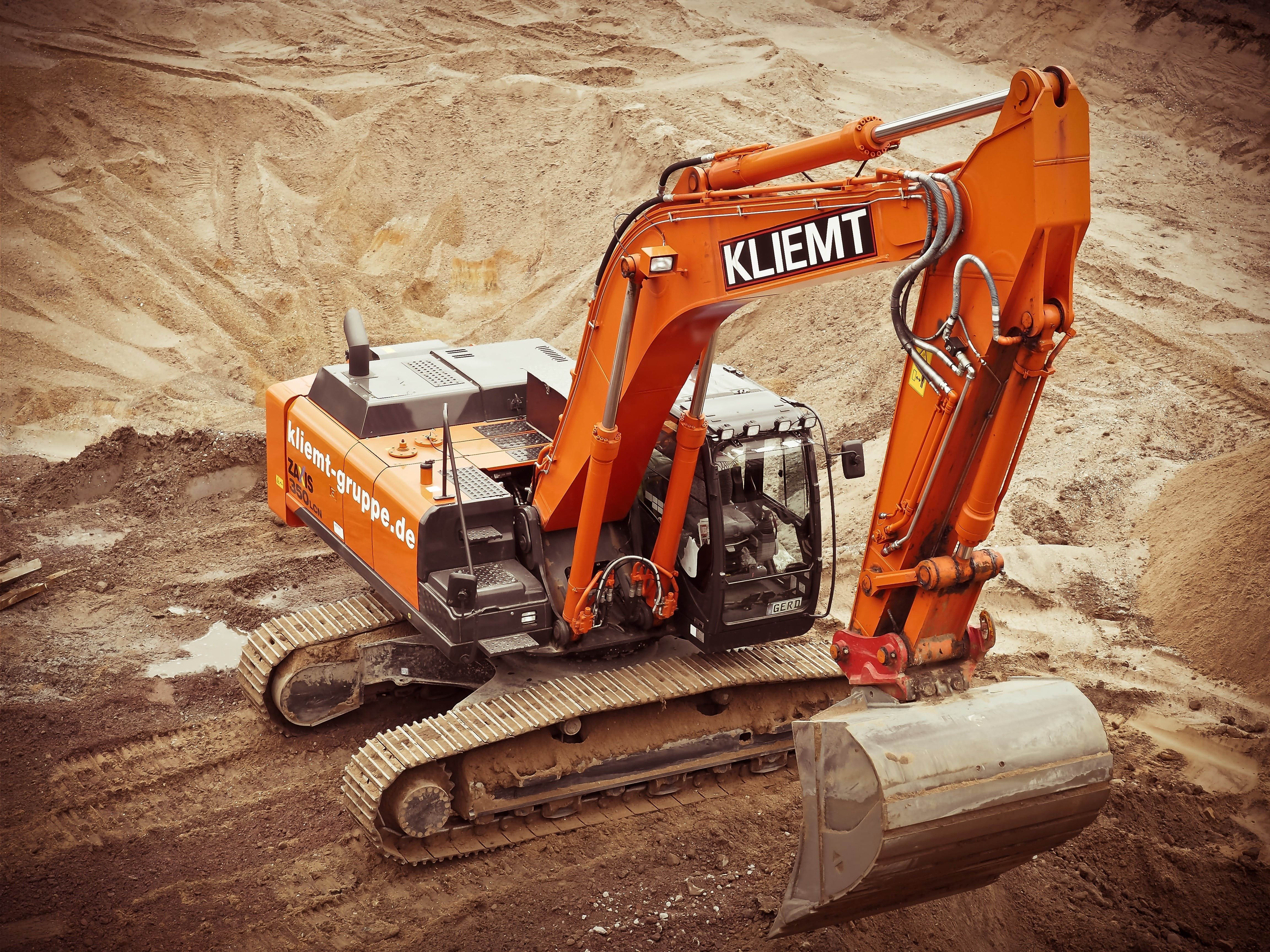 Orange Kliemt Excavator on Brown Soil