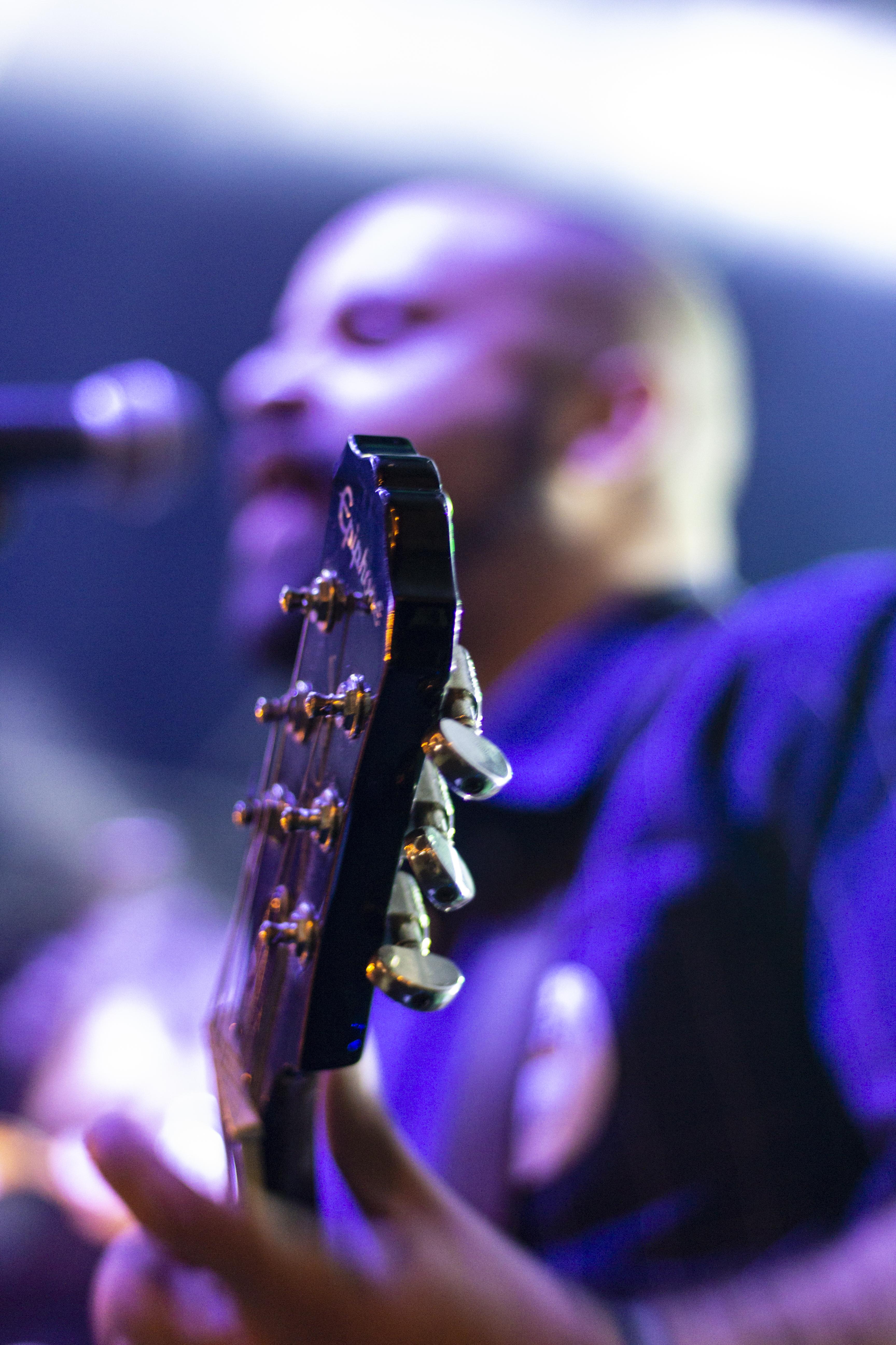 Photo of Man Plying Guitar