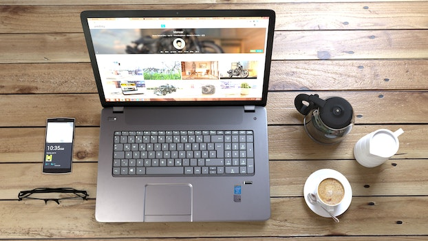 Gray and Black Laptop Computer Near White Ceramic Teacup