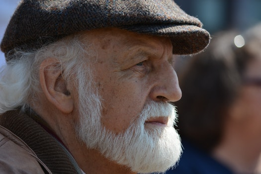 Selective Focus Photography of Man in Flat Cap during Daytime