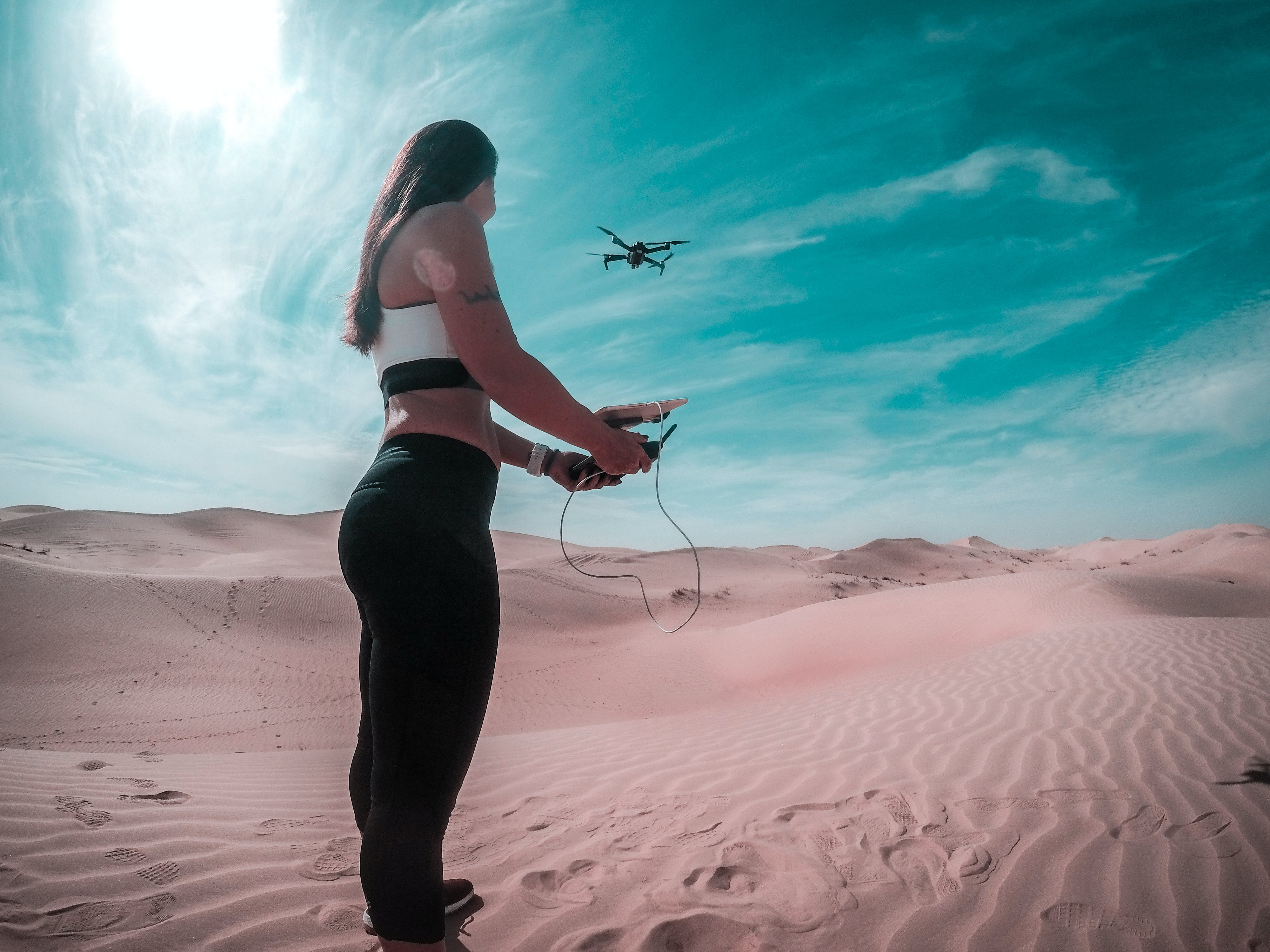 Drone on Mid Air While Woman Holding Controller