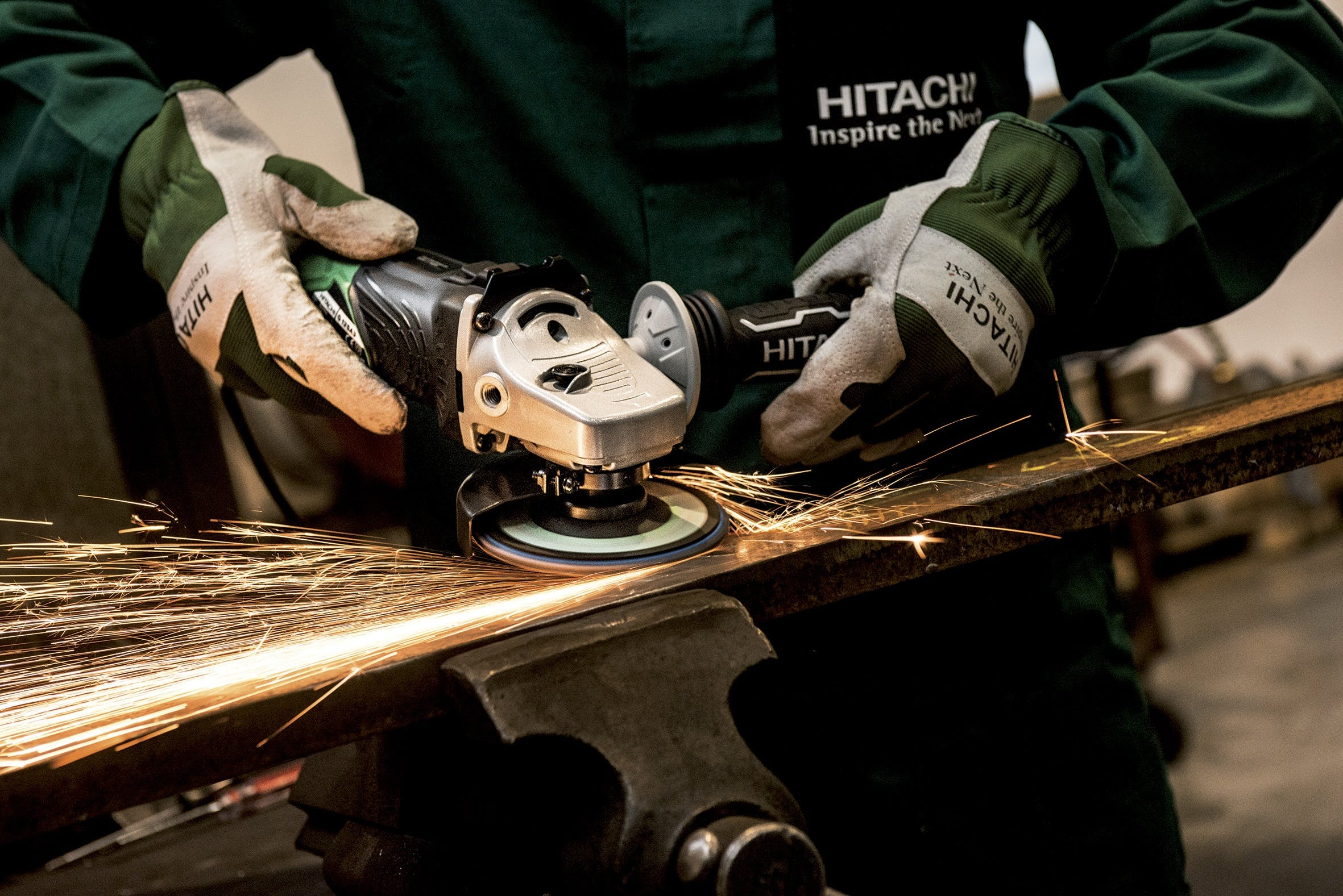 Person Holding Black and Gray Hitachi Angle Grinder