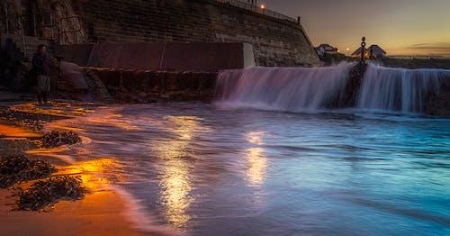 Foto profissional grátis de alvorecer, cachoeiras, cascata, nascer do sol