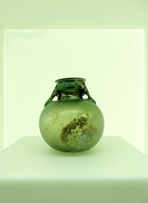 Green Glass Vase on White Surface