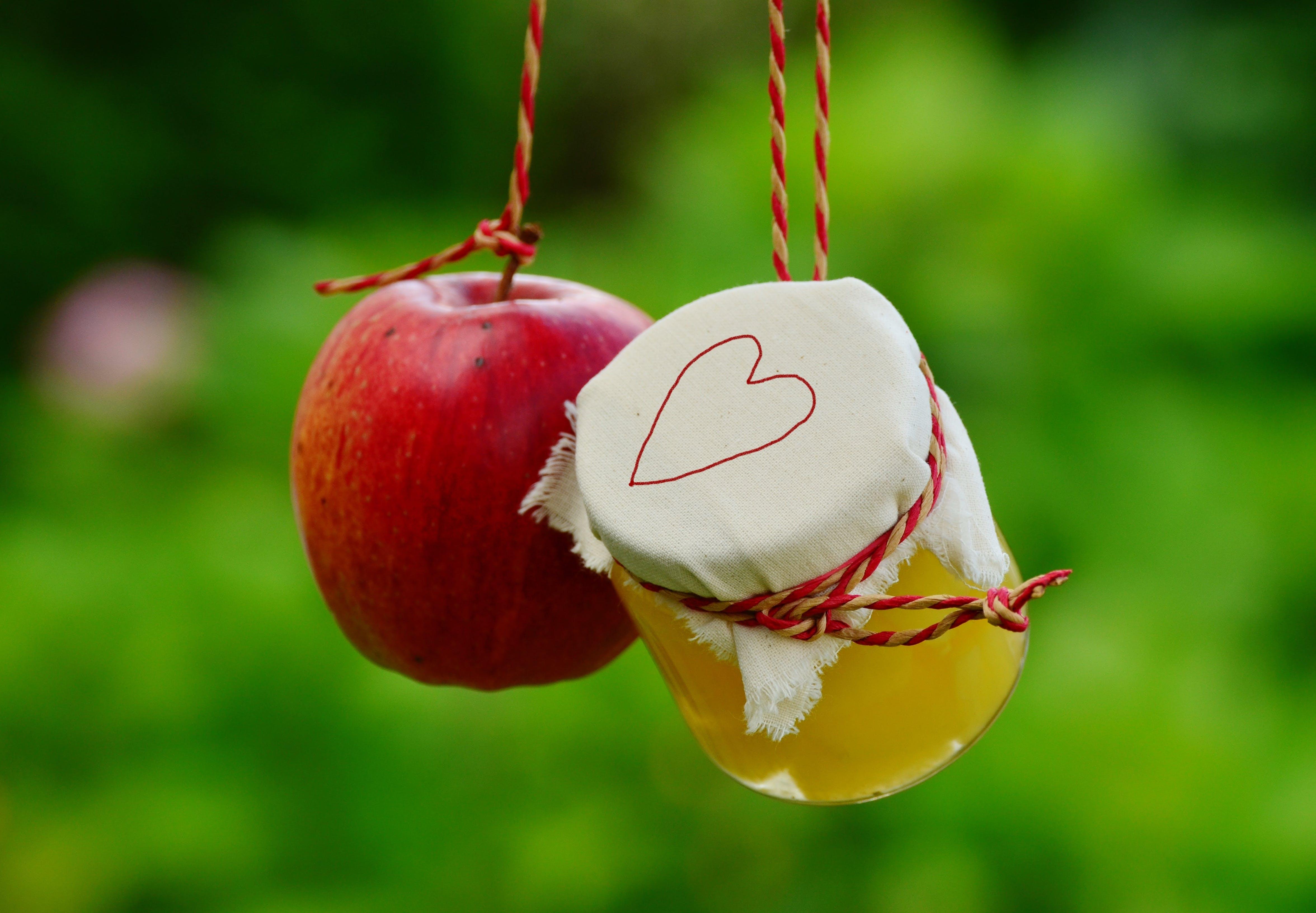 Red Apple Fruit Beside Clear Glass Jar