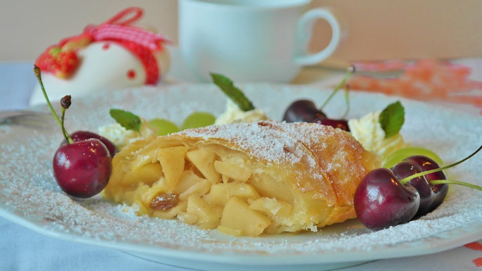 Yellow Pastry and Red Cherry in White Ceramic Dining Plate