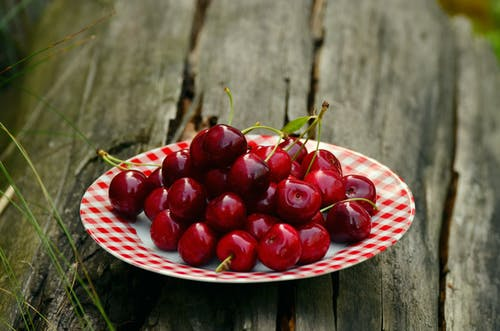 Cherry Fruits on White and Red Ceramic Round Plate