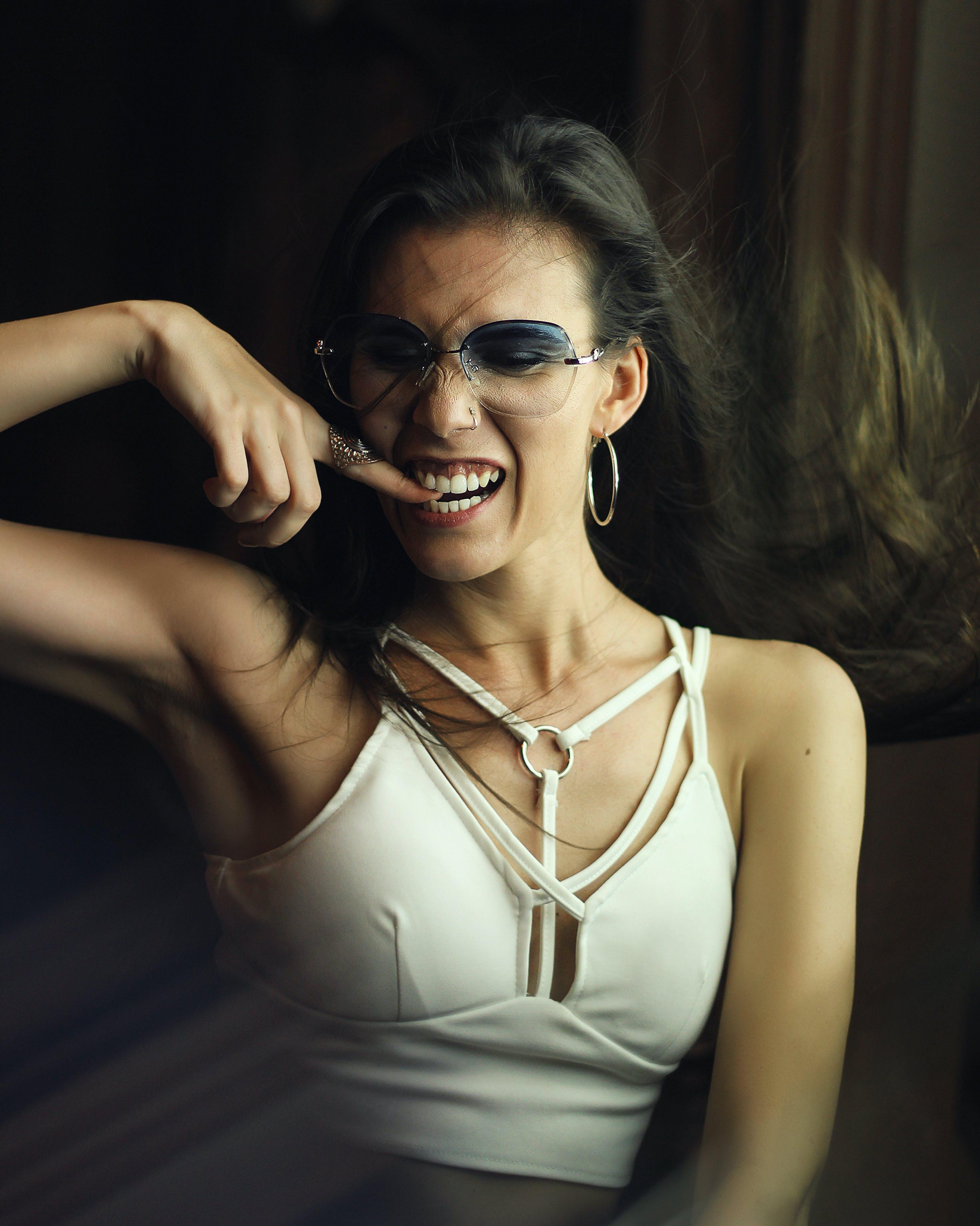 Woman Biting Her Nail