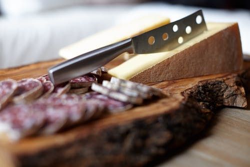 Steel Knife on Chopping Board