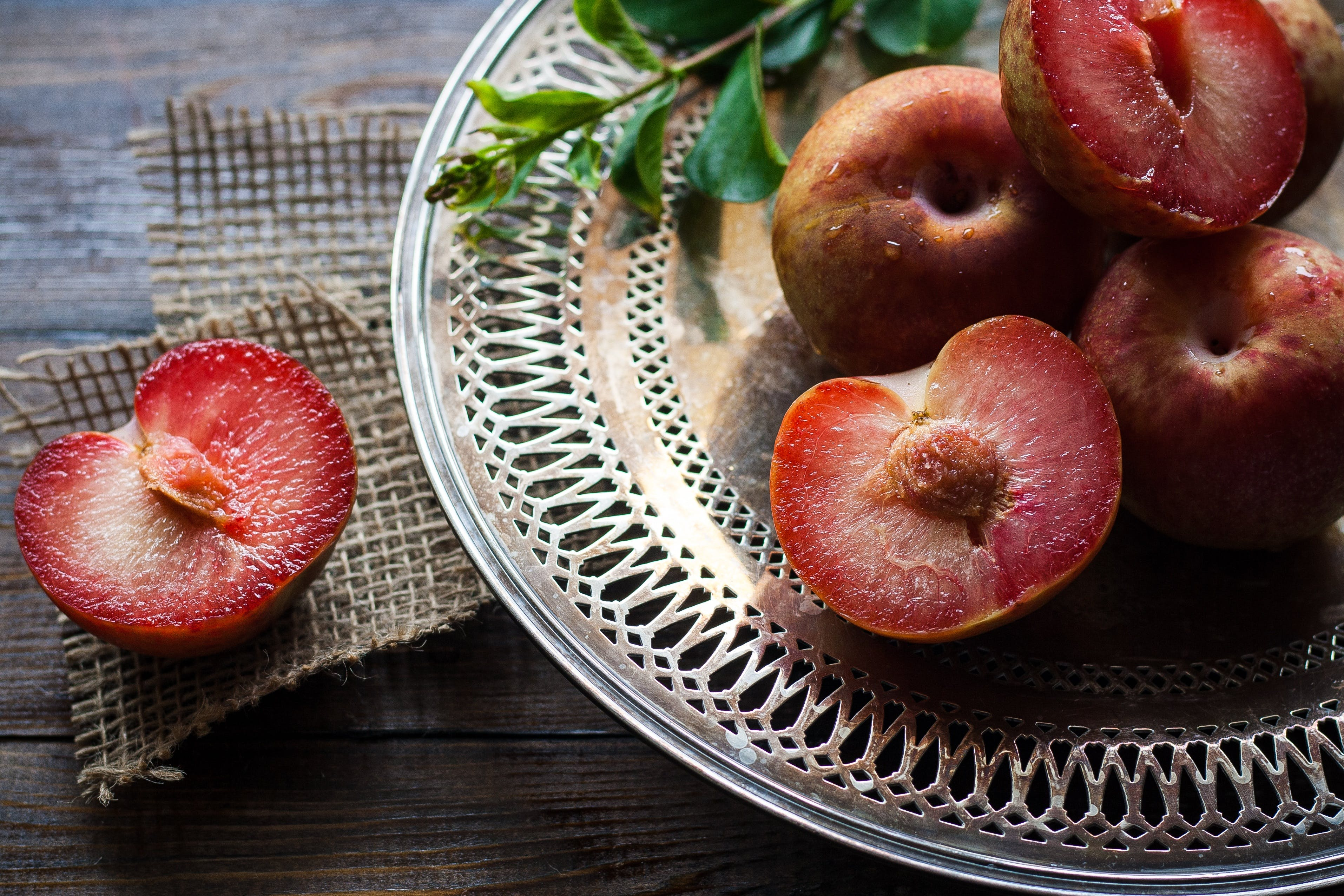 Sliced Plums on Silver Round Platter