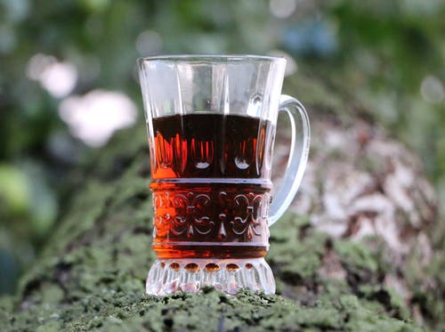 Selective Focus of Clear Glass Mug With Red Liquor