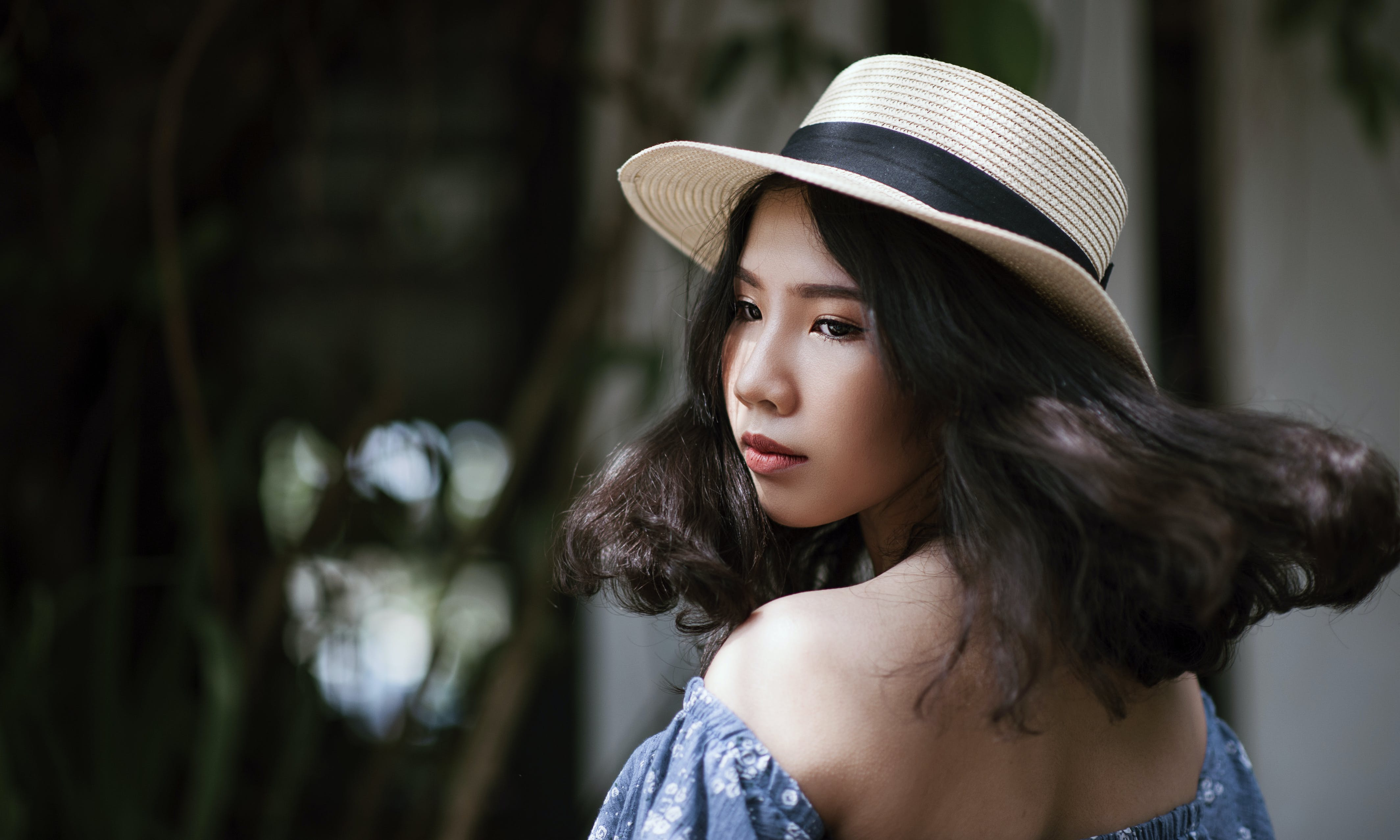 Woman Wearing Fedora Hat and Off-shoulder Blouse