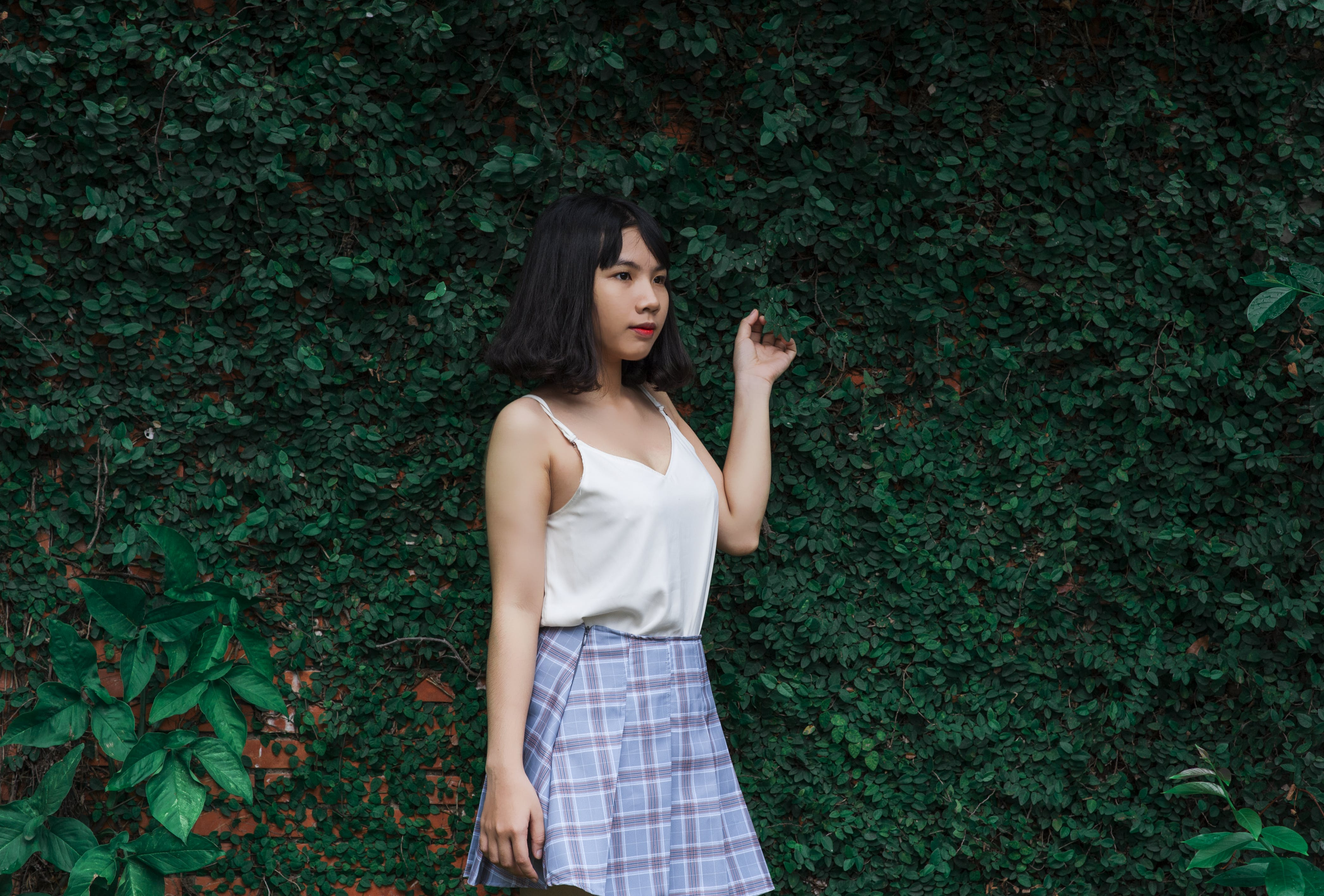 Woman Standing Beside Vine