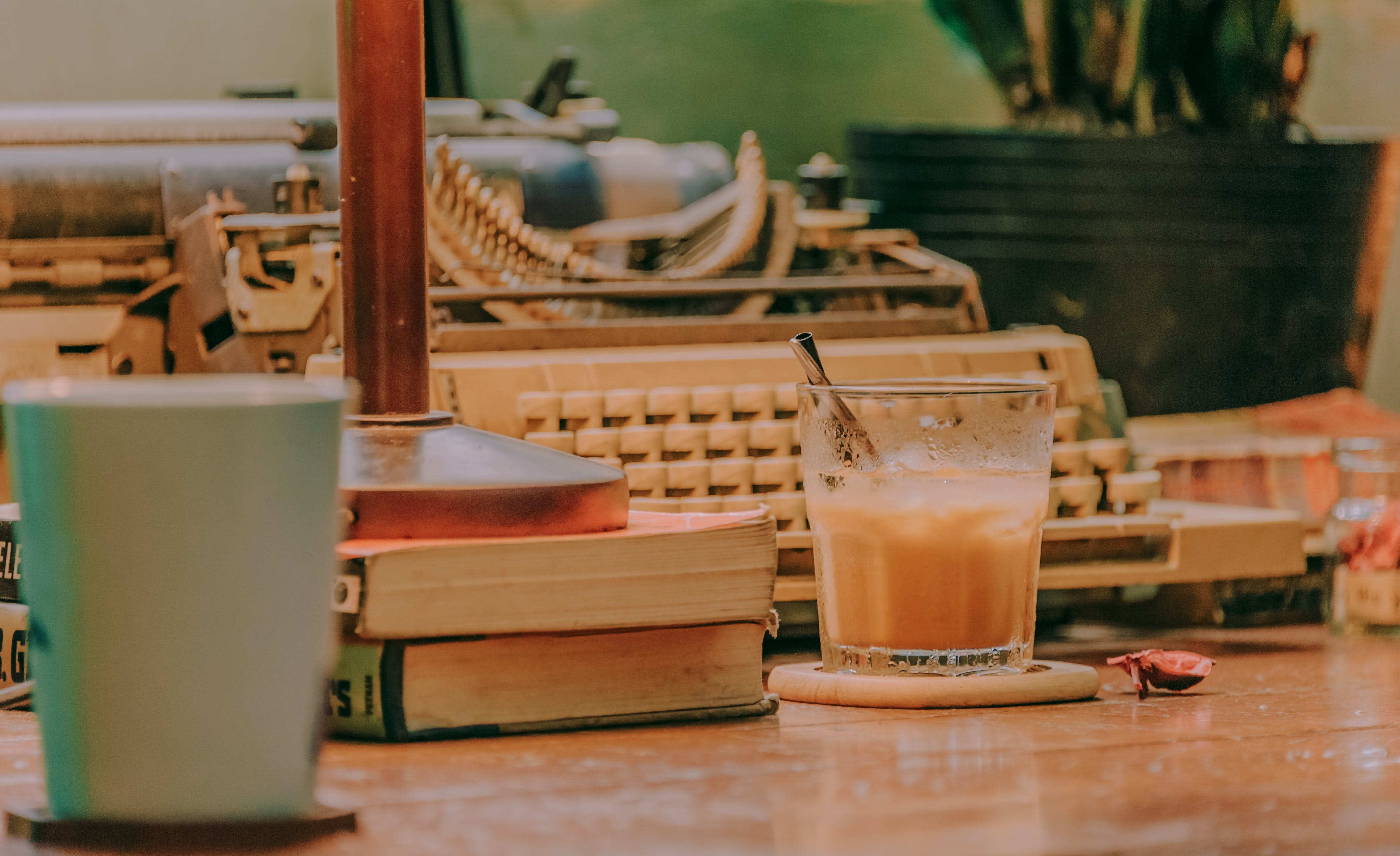 Stack of Books Beside Drinking Glass