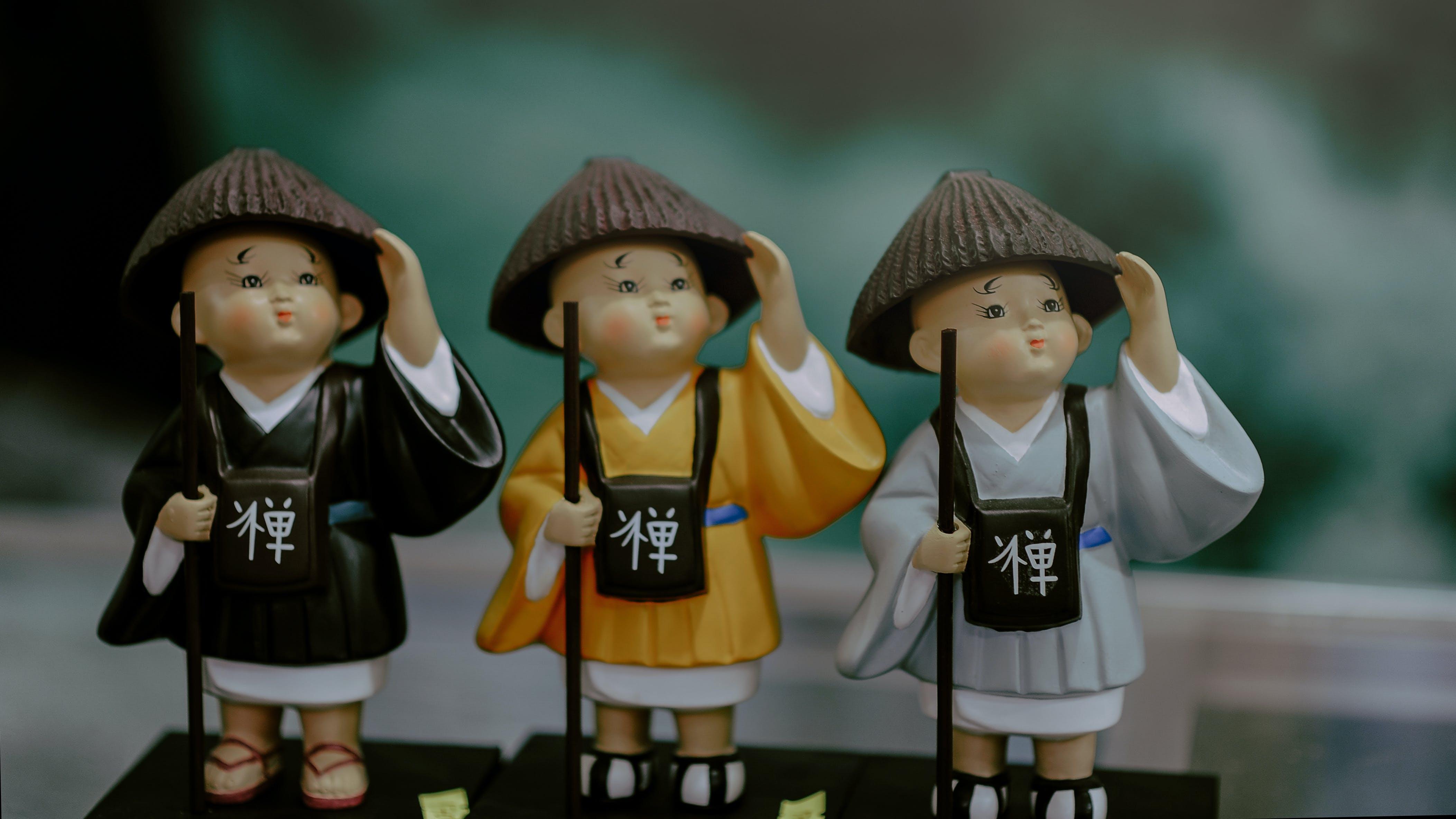 Three Monks Wearing Brown Hat Looking Up Figurines Set