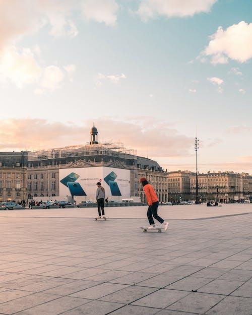 Fotos de stock gratuitas de hacer skate, patinadores, patines, puesta de sol