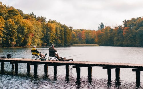 Two Men Fishing on Lake