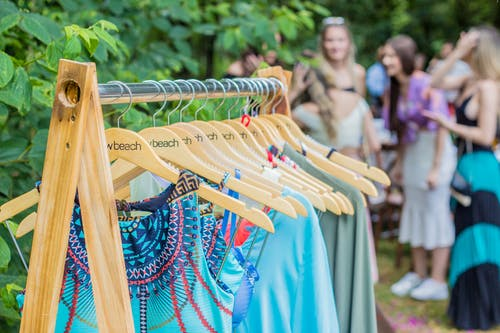 Photo Of Clothes Hanged On Clothes Rack