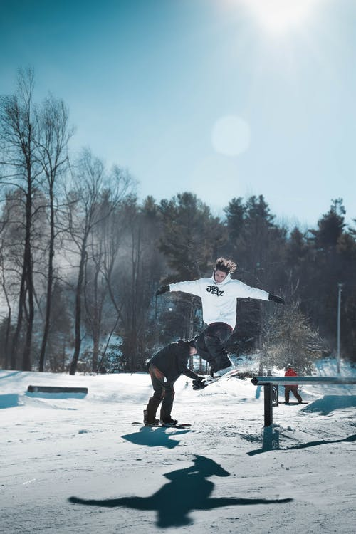 Person Jumping While Using Ski Board