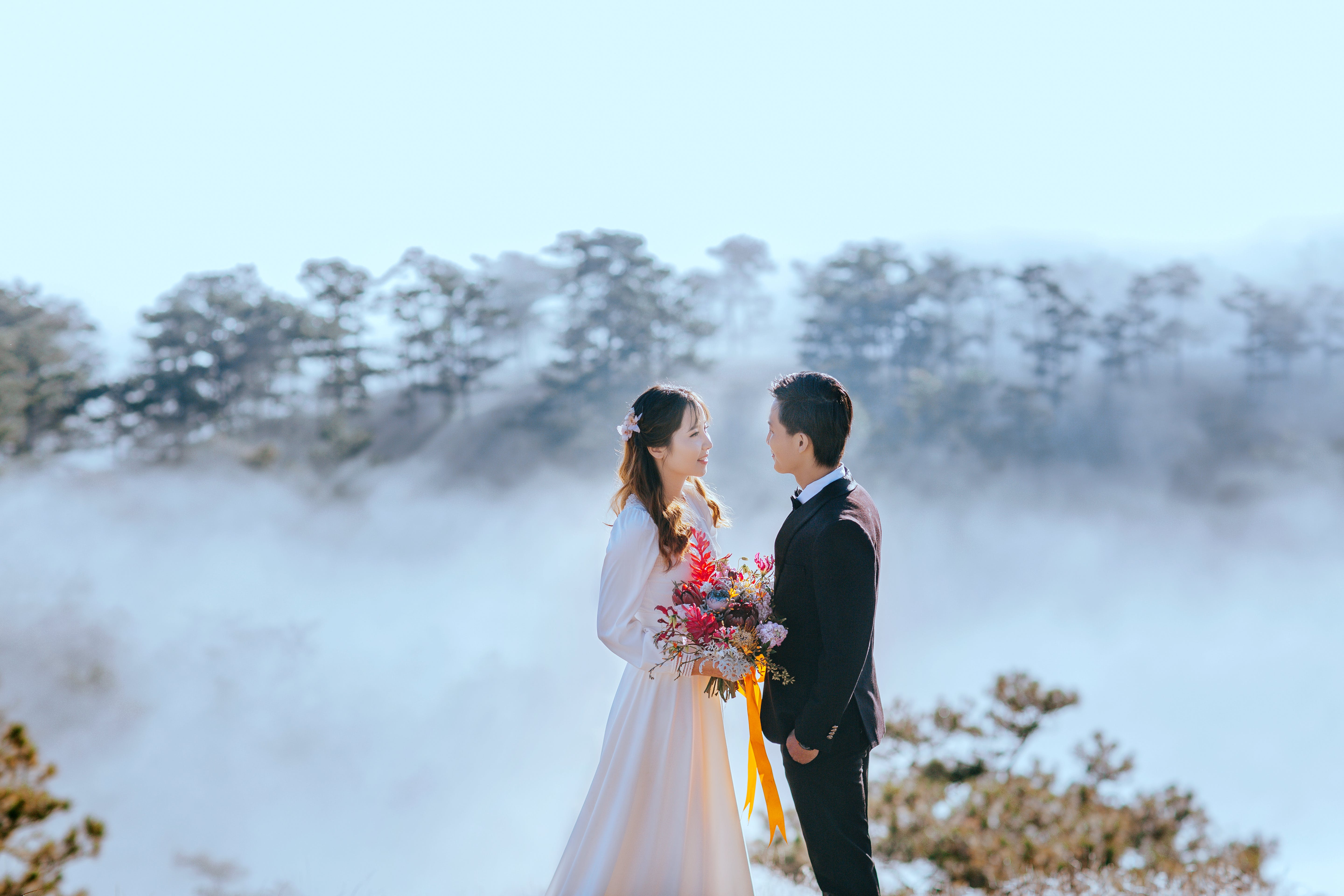 High-angle Photo of Bride and Groom With Background of Seaclouds