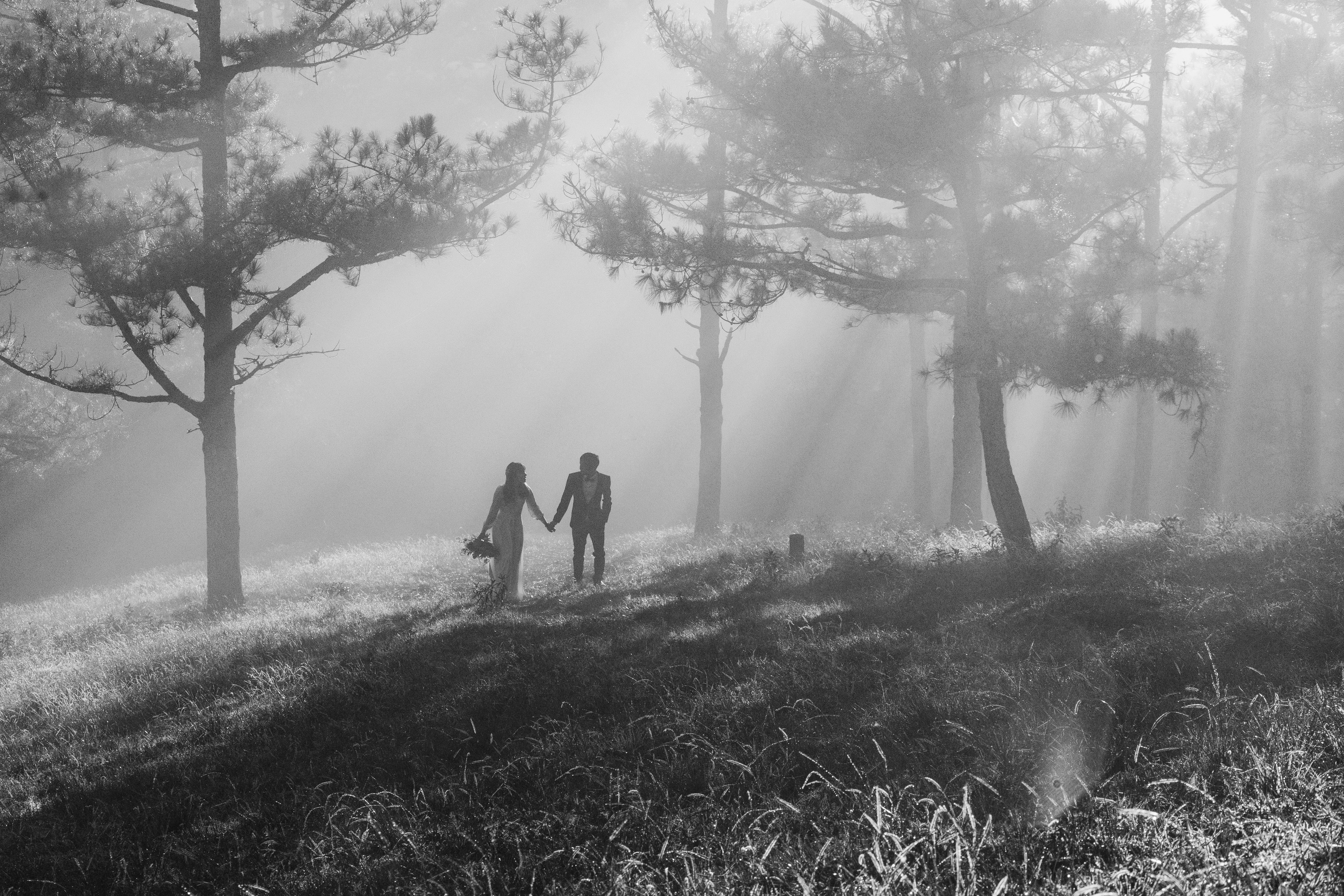 Grayscale Photography of Man and Woman Holding Hands