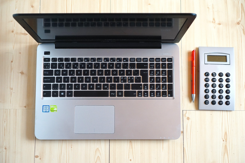 Macbook Pro Beside Gray Rectangular Device