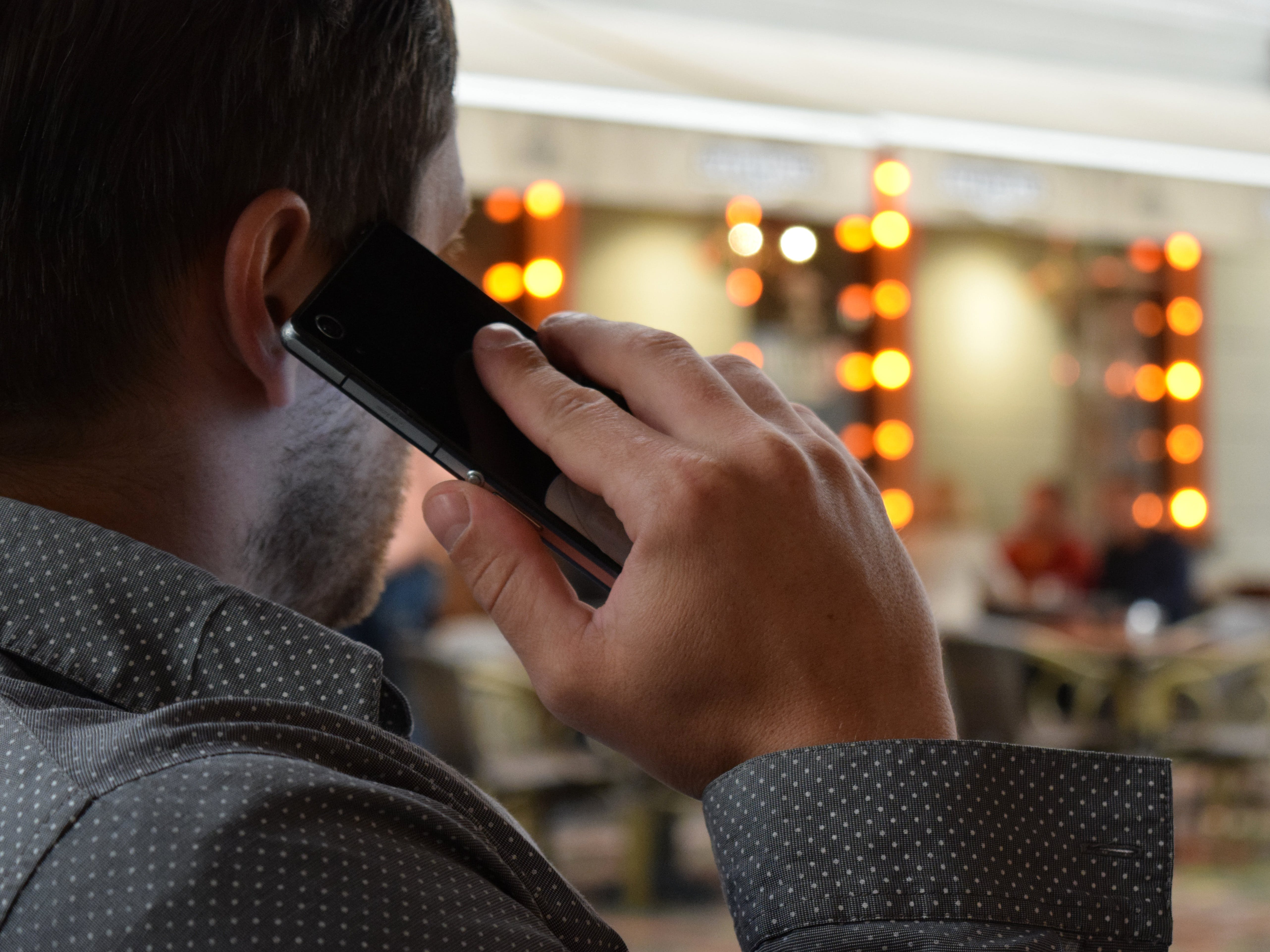 Person Using Phone Selective Focus Photography