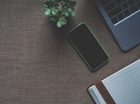 Green Iphone 5c Near Macbook