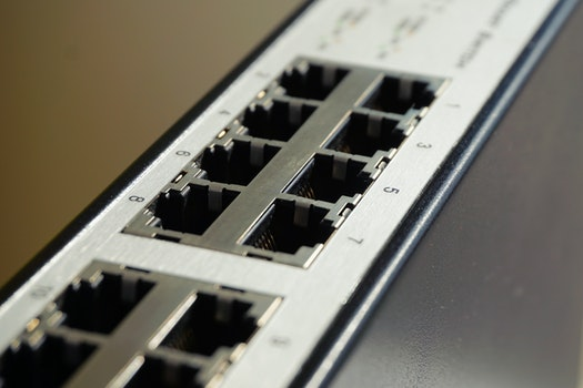 Black and White Lan Port Router in Shallow Focus Photography