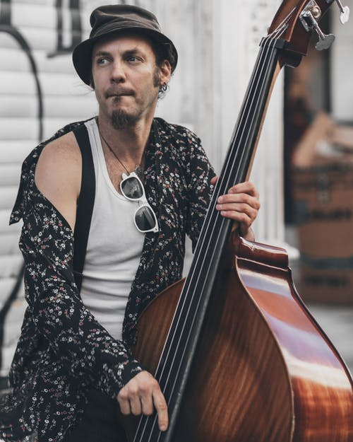 Person Wearing Long-sleeved Shirt Sitting With Double Bass