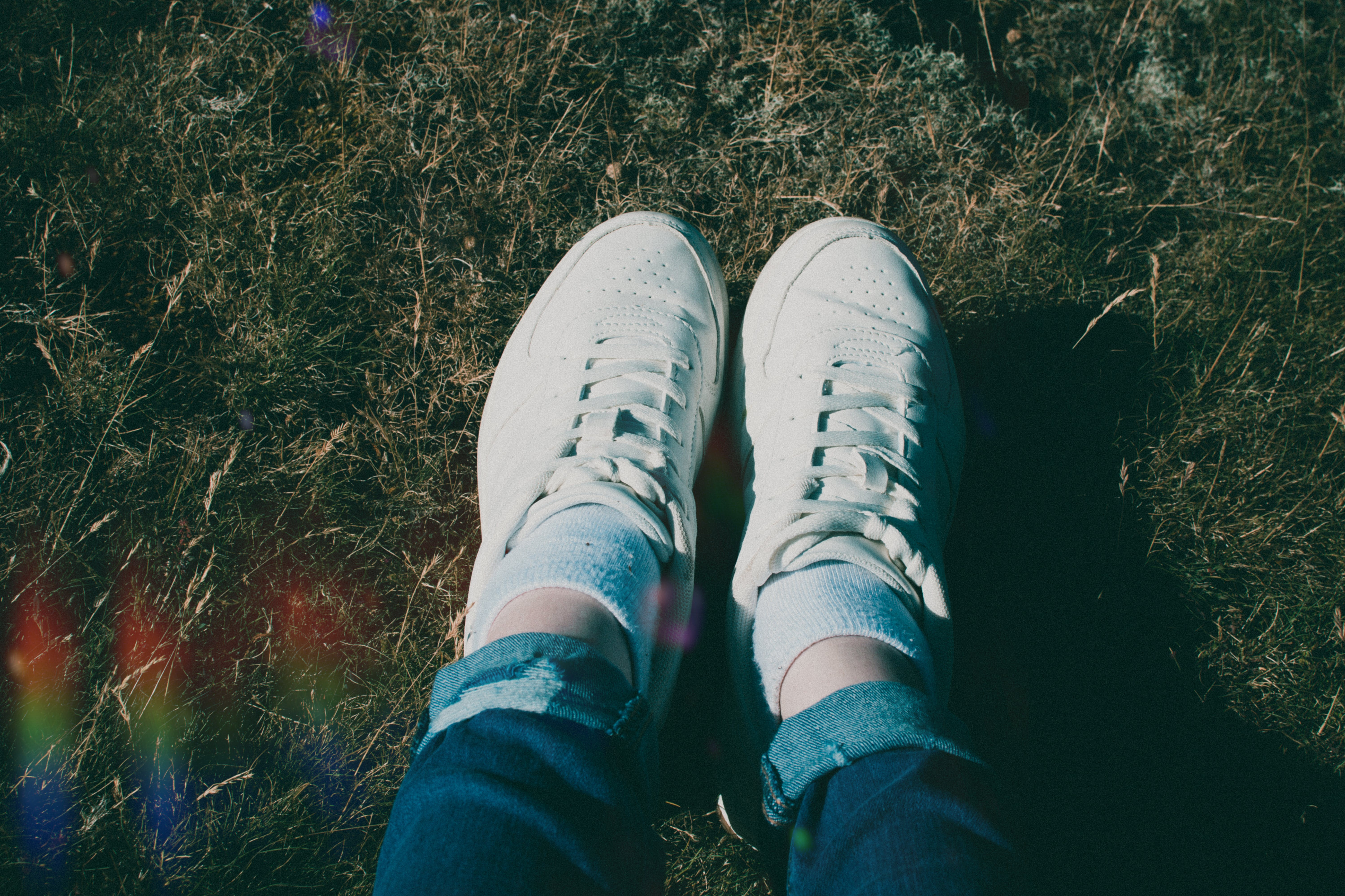 Close-Up Photo of Person Wearing White Shoes