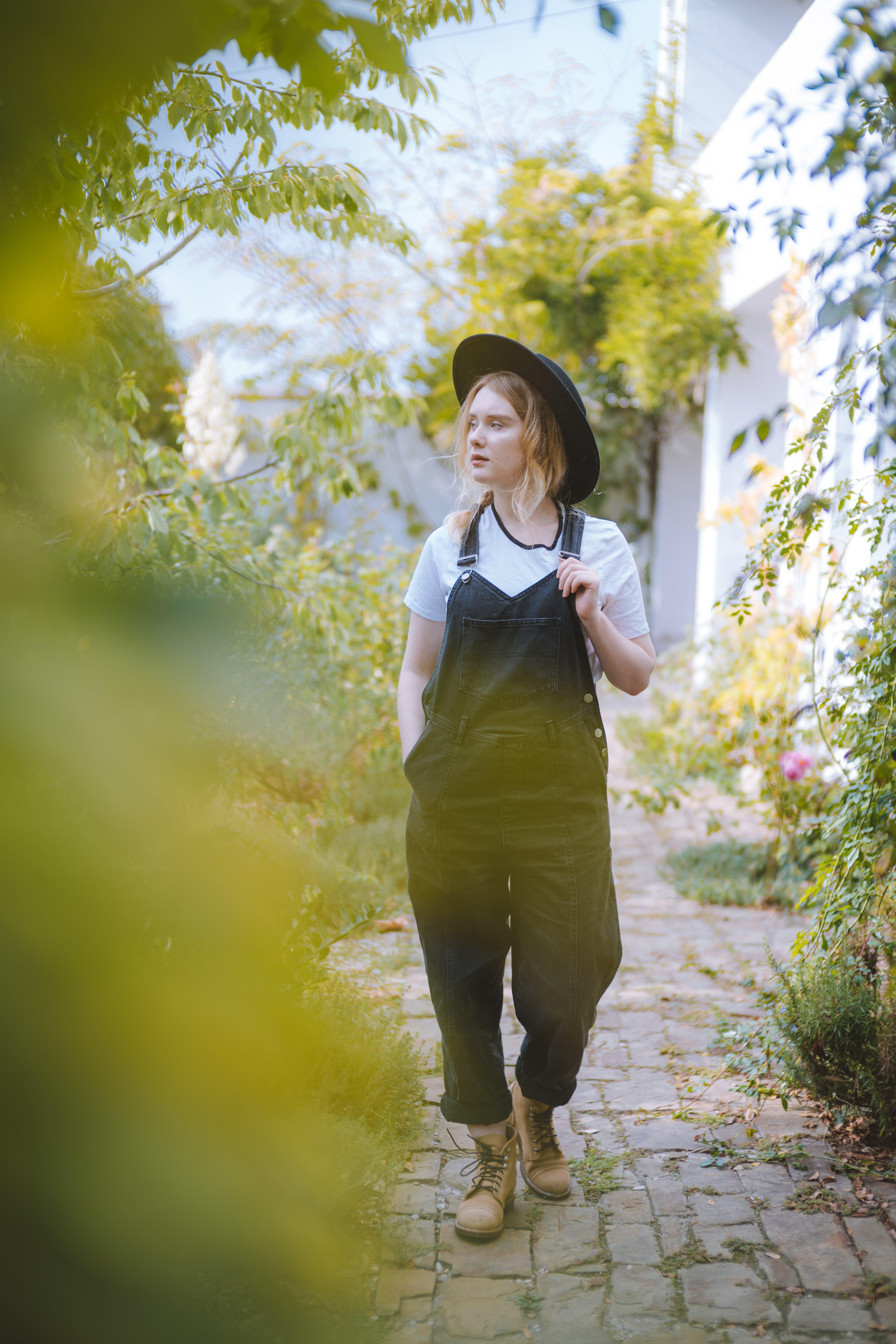 Woman Walking At Garden
