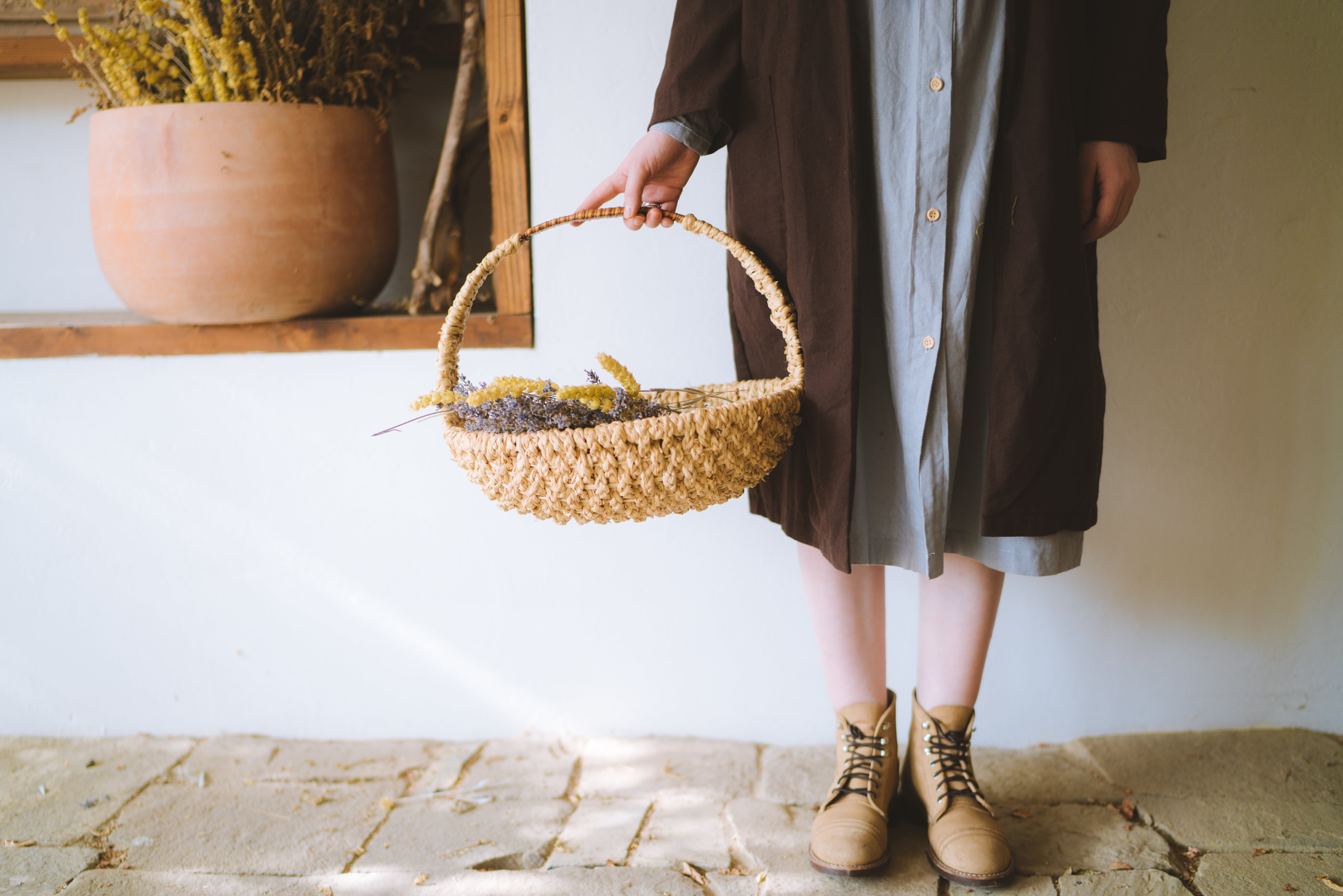 Woman Standing Holding A Basket