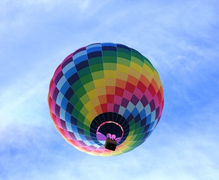 Hot Air Balloon Flying Under Blue Sky during Daytime