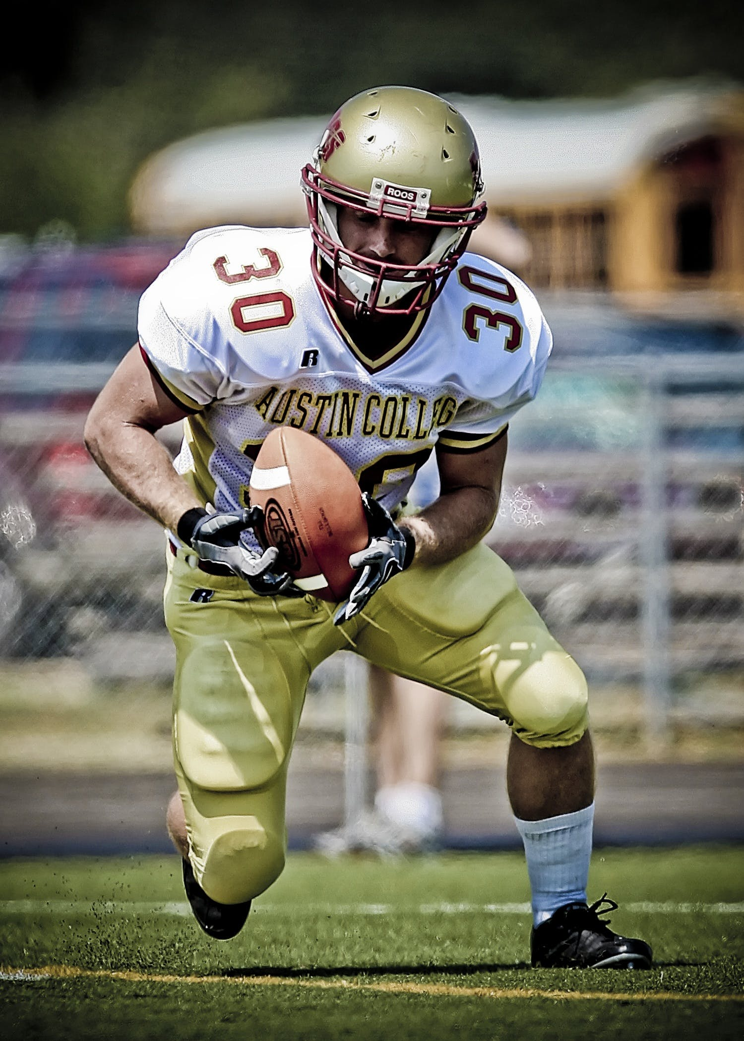 Austin College Football Player Running With Football