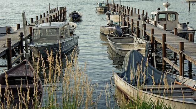 Cluster of Grey Motorboat on Brown Wooden Dock