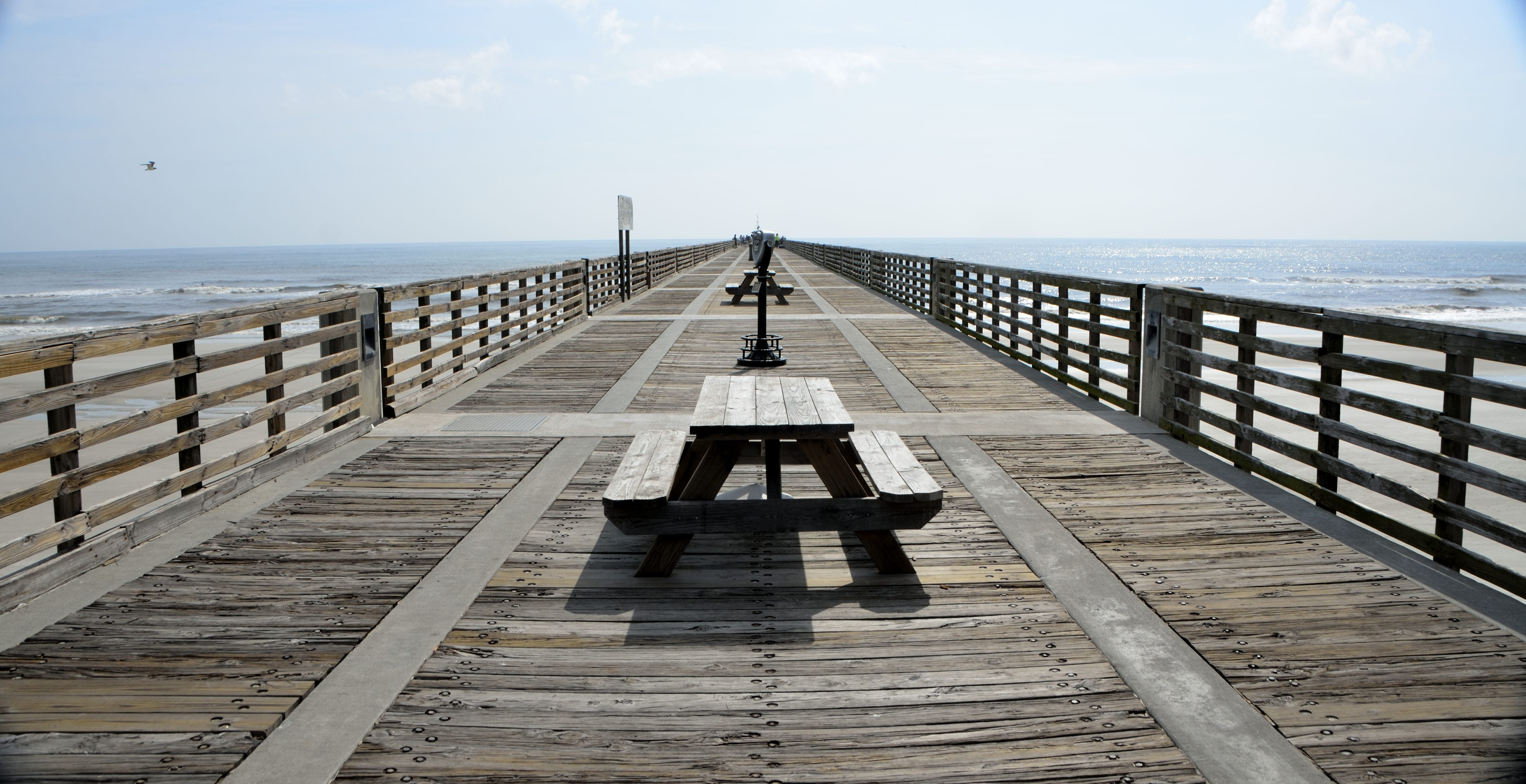 Black Wooden Picnic Table on the Wooden Dock