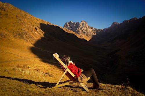 Woman Sitting On Adirondack Chair
