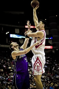Yao Ming Holding Basketball on His Left Hand While Jumping