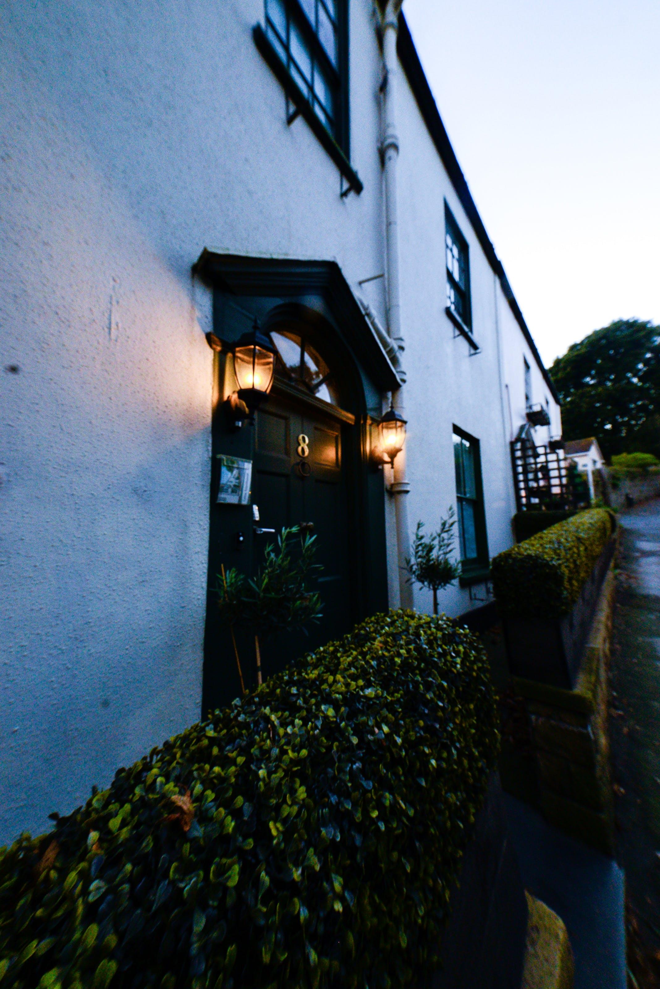 Free stock photo of door, evening sun, fire lantern