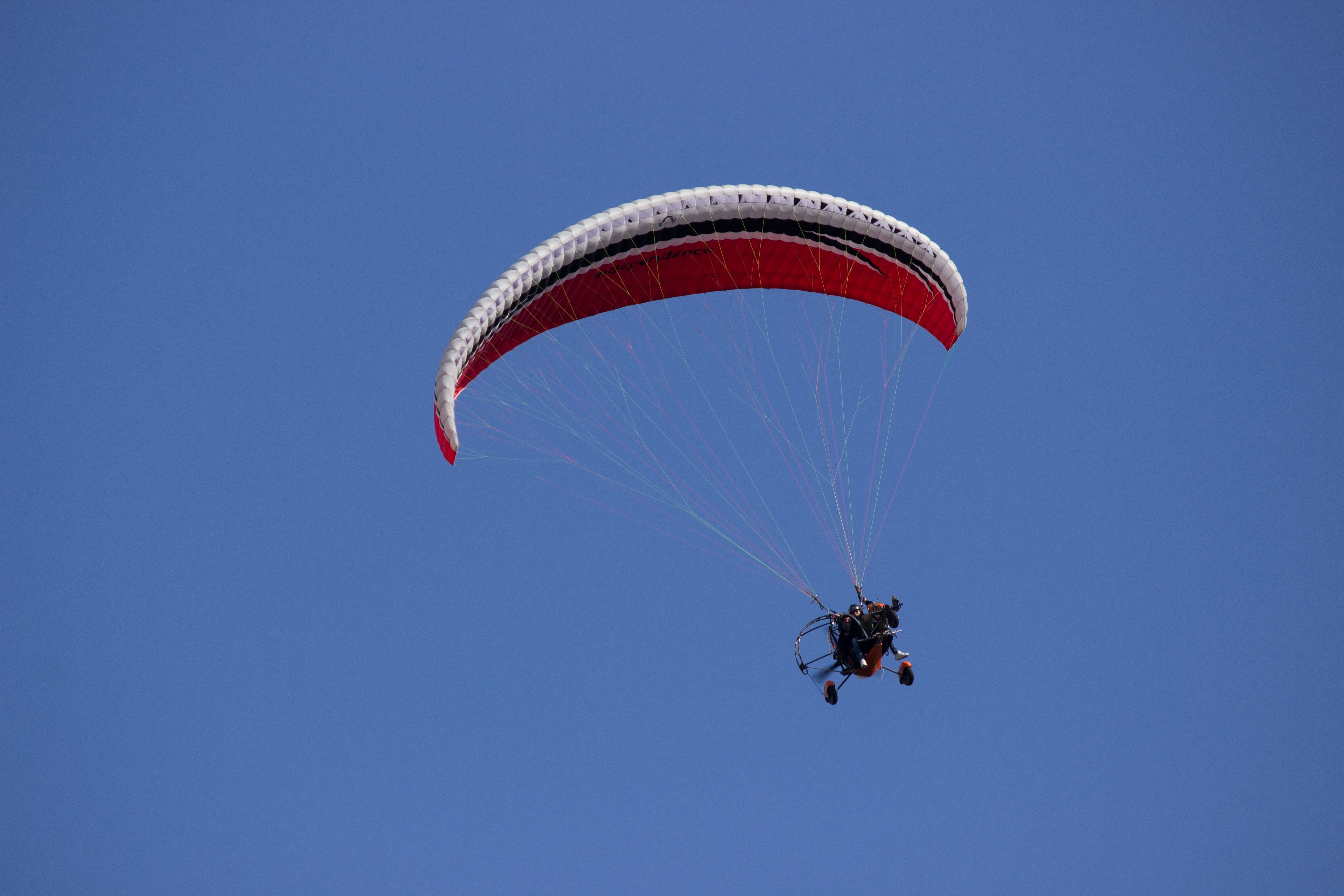 Person In Parachute Gliding Above Mountains 183 Free Stock Photo
