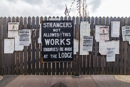 Free stock photo of posters, signs, typography, wooden fence